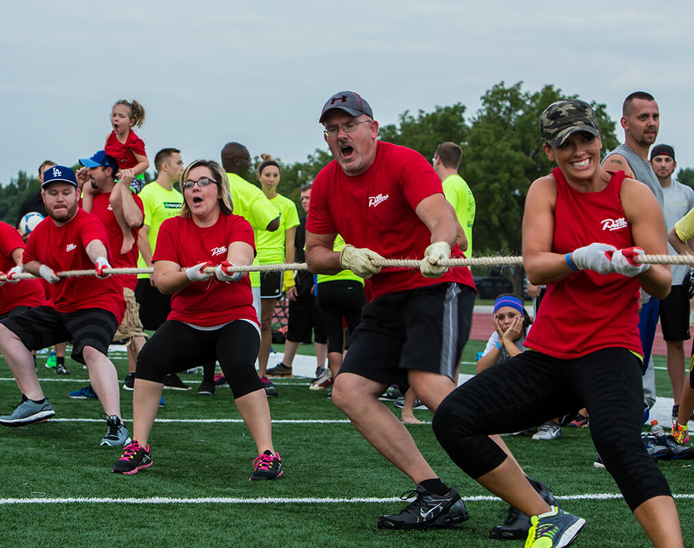 "Teams from different organizations (or combined organization teams) compete in several feature events over the course of 5 days to show off their ""out of the office"" skills in our health and fitness challenge."
